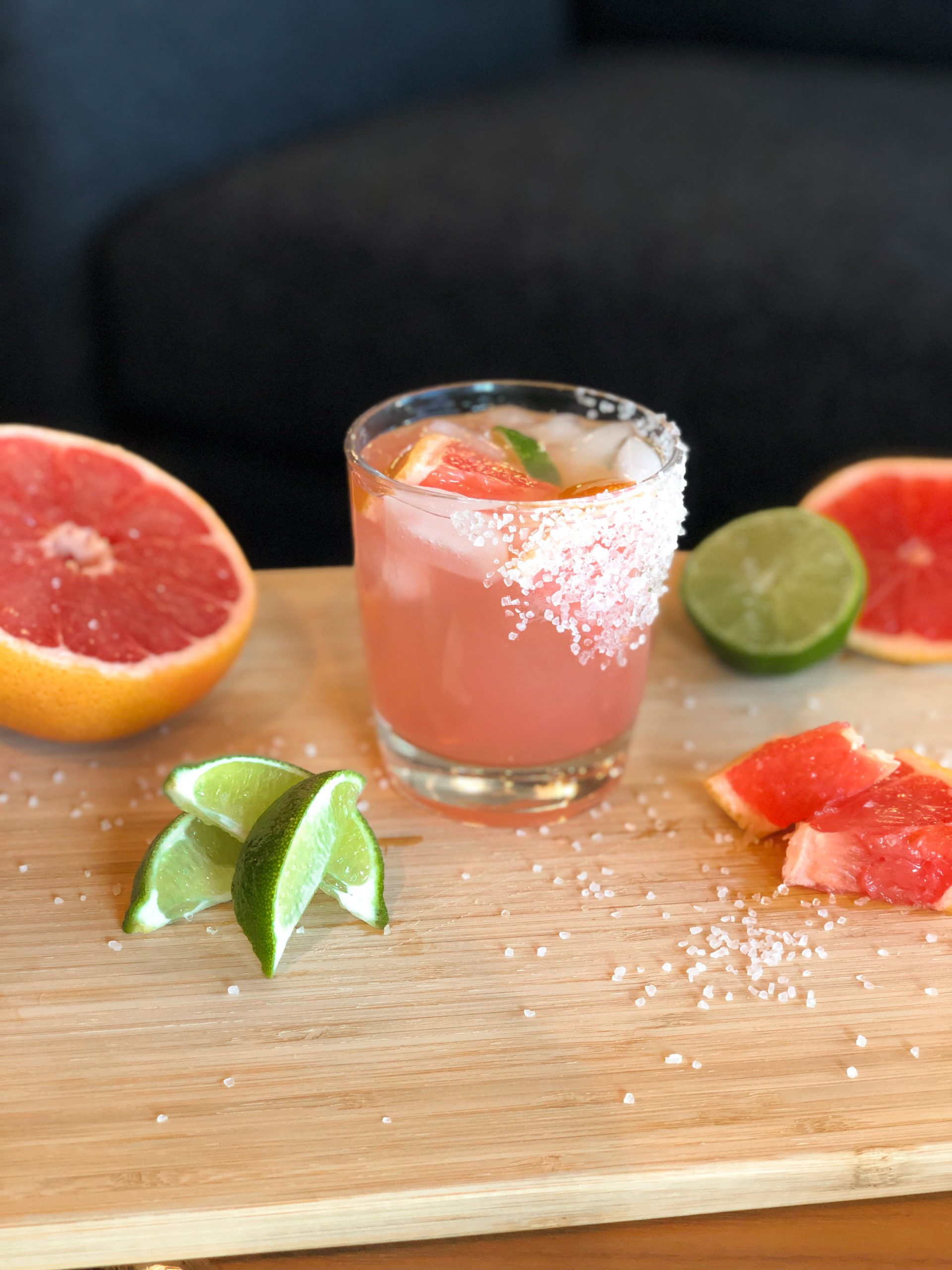 Paloma alcoholic drink with grapefruit and lime garnish